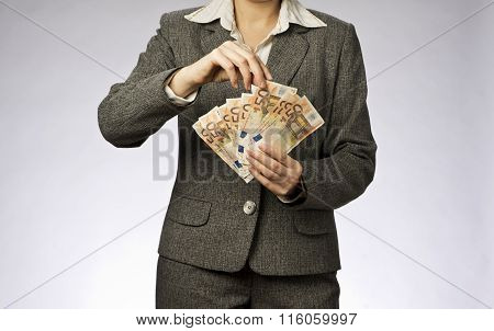 Business woman with money fan