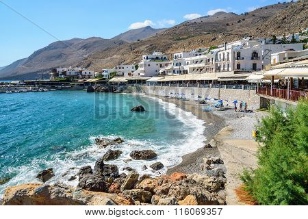 Bay with small beach in centre of Chora Sfakion town, Crete, Greece