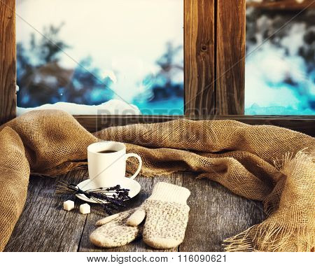 .white Cup Of Coffee Or Tea, Lavender Flowers, Mittens And Natural Gunny Cloth.