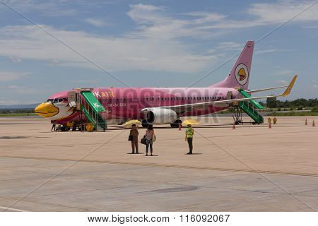 BANGKOK THAILAND - AUGUST 242015 : Nok Air airline and passenger at Khon Kean Airport on August 242015 in Thailand.