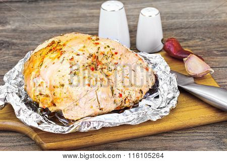 A Piece Turkey in Spices for Grilling on Woody Background