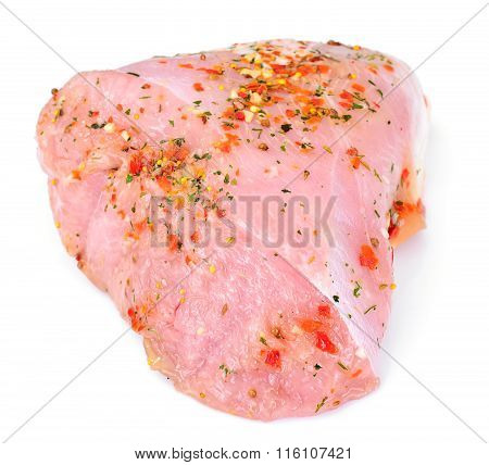 A Piece of Raw Turkey in Spices for Grilling Isolated on White B
