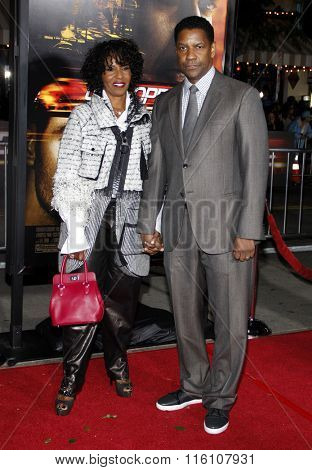 WESTWOOD, CALIFORNIA - October 26, 2010. Denzel Washington and Pauletta Washington at the Los Angeles premiere of