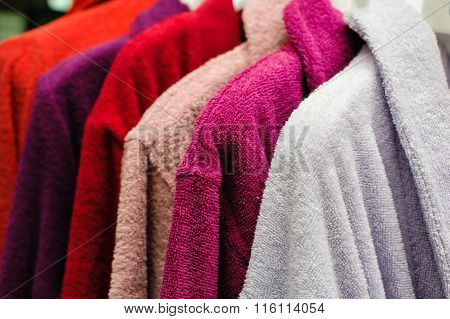 Colored Terry Bathrobes Hanging On The Store Trempel