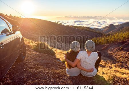 Couple sitting near the car