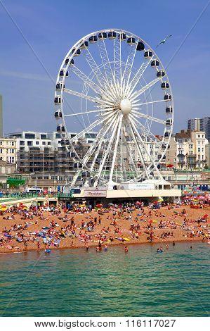 BRIGHTON, JULY 14, 2013:View the golden sand of Brighton beachfront to the  ferris wheel