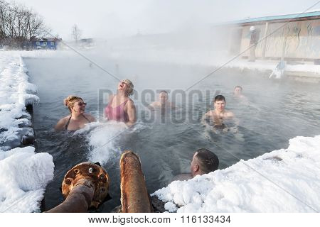 Group Of People Relaxing In Geothermal Spa In Hot Spring Pool