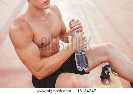 Athlete drinking water after a workout