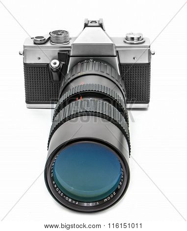 Vintage camera with long telephoto lens on the white background