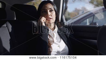 Interior view of woman on phone in limousine