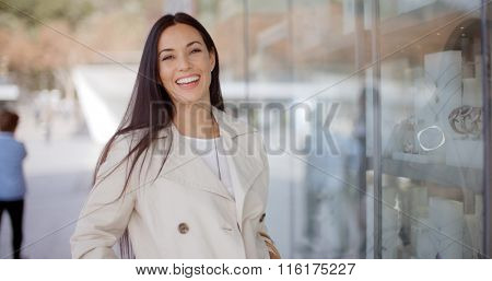 Laughing vivacious woman in a town street