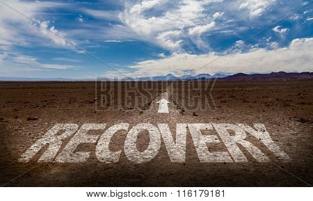 Recovery written on desert road