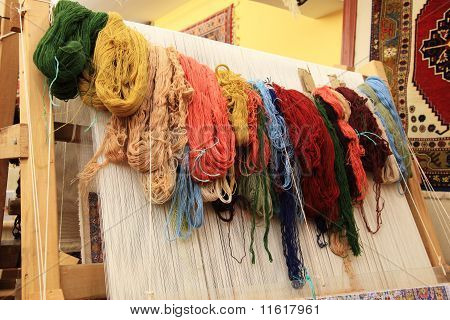 Different Coloured Yarns Hanging On A Loom