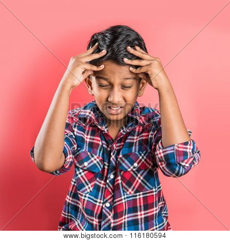indian kid and headache or cephalalgia, asian kid and headache or cephalalgia, indian kid holding head, indian kid pulling hair in pain and stress, yellow background, 10 year indian boy poster