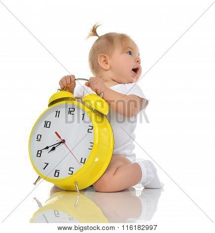 Happy Child Girl Kid Sitting With Big Yellow Alarm Clock