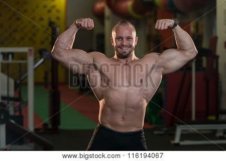 Muscular Men Is Hitting Rear Double Bicep Pose