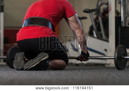 Man Putting Straps For Safety Bodybuilding Exercise