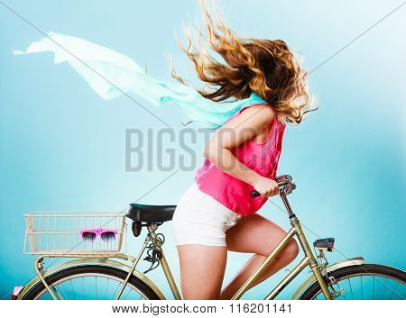 Active Woman Riding Bike Bicycle. Hair Windblown.