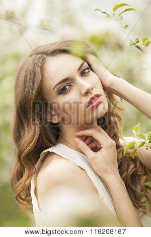 Portrait Of A Brunette Girl In The Garden