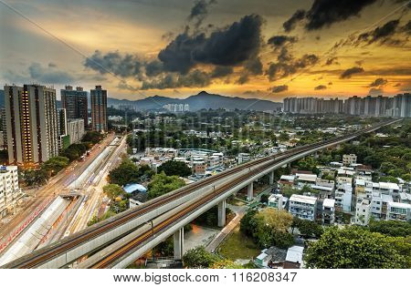 hong kong cityspace and speed train at sunset