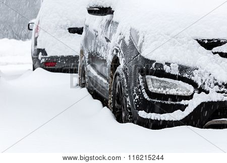Snow-covered Cars In Town