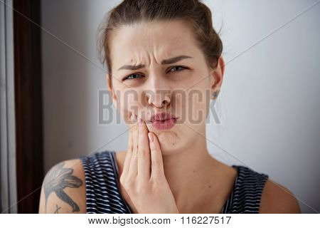 Closeup Portrait Of Young Woman With Sensitive Toothache Crown Problem About To Cry From Pain Touchi