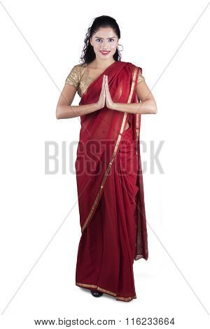 Friendly Indian Woman Shows Greeting Gesture