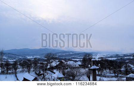 Small rural village buildings in the middle of the winter under heavy snow