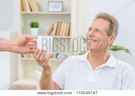Senior man holding cup of  tea