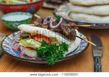 Souvlaki or kebab, grilled meat skewer and pita bread