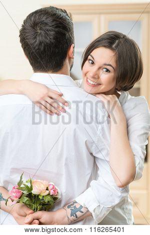 Positive couple embracing