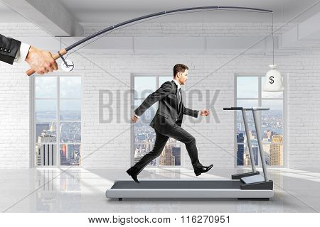 Profit-seeking Concept With Businessman Running On A Treadmill For A Bag Of Money Hanging On A Fishi
