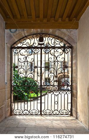 window with iron window grate in famous hospice in Beaune France