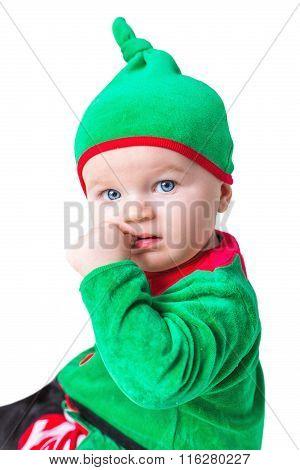 A Little Boy Dressed As An Elf