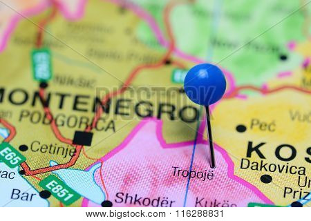 Photo of pinned Tropoja on a map of Albania. May be used as illustration for traveling theme. poster