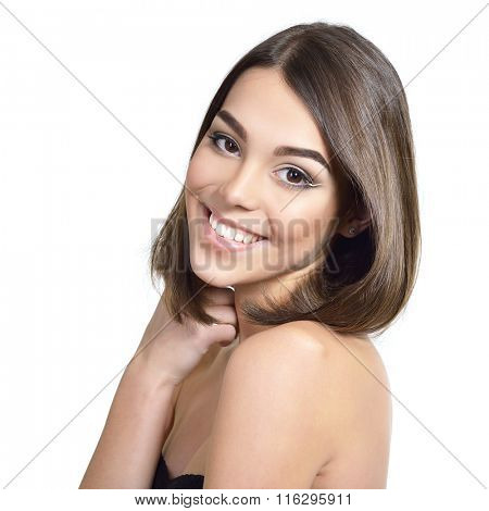Beauty portrait of attractive smiling teen girl with hazel eyes, brown hair and beautiful makeup. Health care, spa, natural beauty beauty treatment, body care concept.