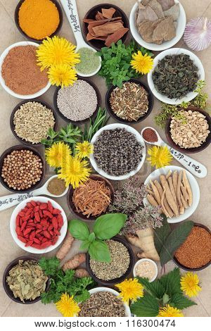 Spices and herb selection used in natural alternative herbal medicine and for culinary purposes on hemp paper background.