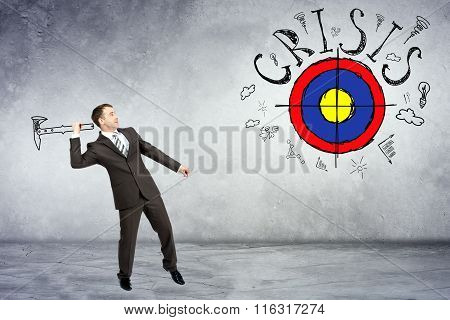 Businessman throwing axe to darts