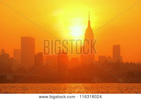 NEW YORK CITY, NY - JUL 11: Empire State Building at sunrise on July 11, 2014 in New York City. It is a 102-story landmark and was world's tallest building for more than 40 years.