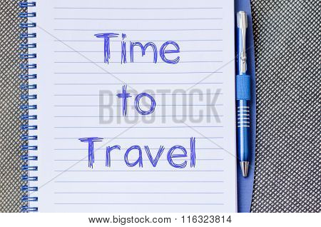 Time to travel text concept write on notebook with pen