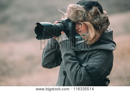 Woman photographer making images in the  park