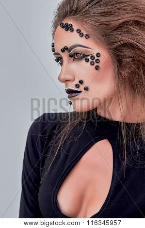 Girl, fashion makeup, black beads on face, dark lips,  portrait.