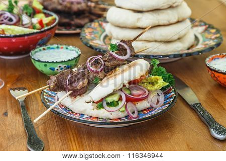 Souvlaki or kebab, grilled meat skewer and toasted bread