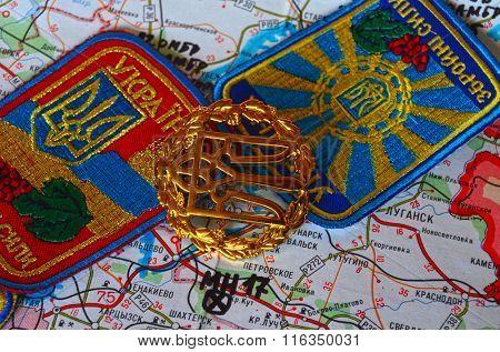 Cockade of Ukrainian Army. Eastern Ukraine map with site of MH-17 flight crash as background. At January 31,2016 in Kiev, Ukraine