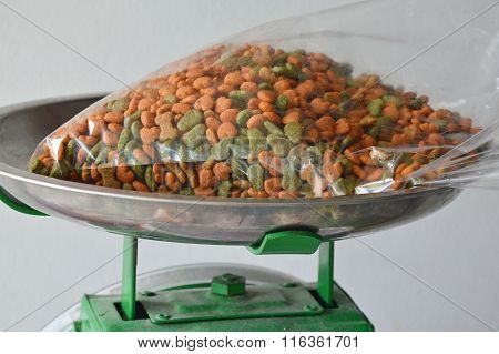 dog food in plastic bag on iron weighing scale tray