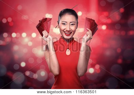 Chinese Woman In Tradional Clothing Holding Angpao