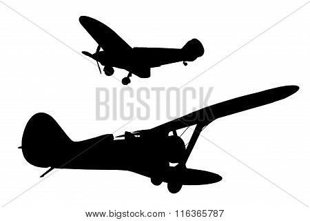 Silhouettes of two military aircraft isolated on a white background.