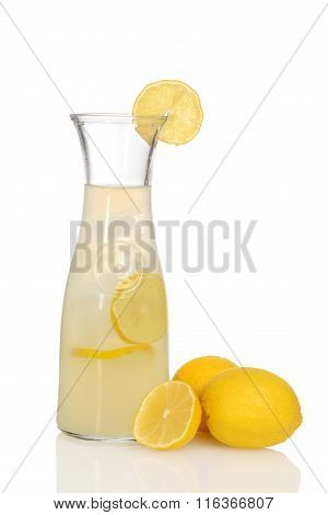 closeup lemonade in pitcher with lemons