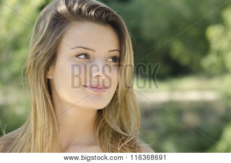 Portrait Of A Beautiful Girl With Blond Hair