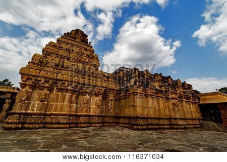 Artistic temple gopura of a south Indian Hindu temple captured against cloudy sky background